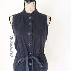 "GAP Button Front Utility Vest Utility vest with drawstring waist, front pockets, mandarin collar, and large round buttons. From the GAP. Charcoal gray/faded black type color. 100% cotton. Size L. Bust is 19"" and length is 25.5."" Excellent condition. Lightly worn. Thanks for looking! GAP Jackets & Coats Vests"