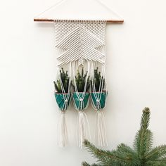 New macrame wall hanging by Macrame Adventure - A macrame plant hanger for your mini Christmas trees or plants. Available now in my Etsy shop.