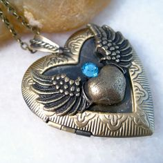 Blue Sapphire Angel Wing Heart Brass Picture Locket Pendant Necklace ❤ liked on… Citrine Pendant, Pendant Set, Heart Locket Necklace, Pendant Necklace, Wing Necklace, Real Gold Chains, Blue Sapphire Necklace, Jewelry Stores Near Me, Necklace Types