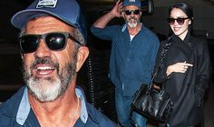 Mel Gibson, 60, and girlfriend Rosalind Ross, 25, all smiles at LAX