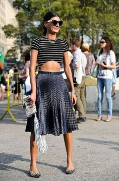 Everyone notice that pleated skirts made a comeback and aren't going anywhere – at least for now. By the way, dresses did too. And Giovanna Battaglia, this style's queen, inspires us on how to wear them.