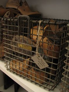 I love these wire storage crates, with brass labels