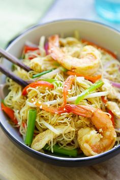 Singapore Noodles - curry-flavored fried rice noodles with chicken and shrimp. The BEST Singapore noodle recipe to try at home!