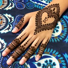 These are quite common Simple Arabic Mehndi designs among the girls. Let's check out the latest mehndi Arabian designs collection in Henna Hand Designs, Henna Flower Designs, Pretty Henna Designs, Mehndi Designs Finger, Simple Arabic Mehndi Designs, Mehndi Designs For Beginners, Modern Mehndi Designs, Bridal Henna Designs, Mehndi Design Images
