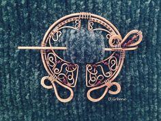 Penannular brooch with carnelian beads.
