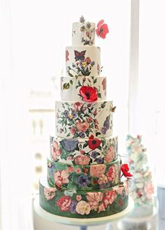 17 Creative Wedding Cake Ideas You Never Seen: Beautiful painted blooms cover nearly every inch of this regal seven-tiered cake. http://www.colincowieweddings.com/food-and-drink/17-wedding-cakes-that-will-make-you-forget-all-other-cakes