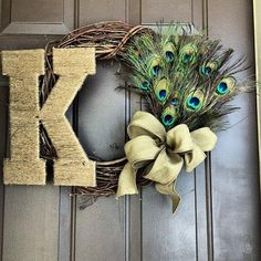 This peacock monogram wreath is a twist on the new trend of door monograms. It's perfect for indoors and outdoors!