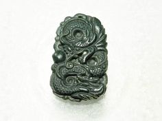 Natural Green Hand Carved Chinese Hetian Jade Pendant by JacsStash