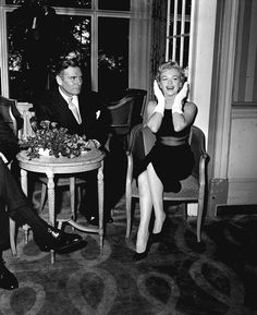 """Marilyn Monroe and Laurence Olivier at the Savoy Hotel in London for the press conference announcing """"The Prince And The Showgirl"""", 1956."""