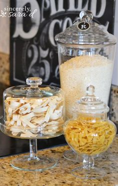 ideas for how to decorate and accessorize a kitchen countertop with glass containers and food