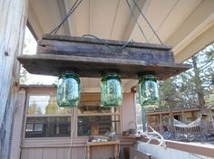 Barnwood, Mason Jars and Christmas Lights Hanging Light - Saw something like this online. Did not want to use candles or fake tea lights. Did not want to see th…