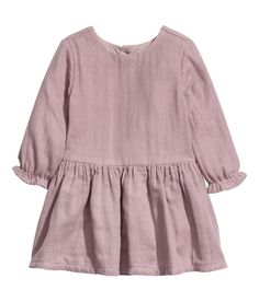 Check this out! BABY EXCLUSIVE/CONSCIOUS. Dress in soft organic cotton with buttons at back and long sleeves with ruffle trim. Seam at waist and flared skirt. Lined. - Visit hm.com to see more.