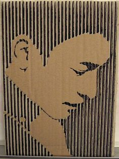 Cutout cardboard art - made by cutting off the top layer of corrugated cardboard to reveal the inner layer.