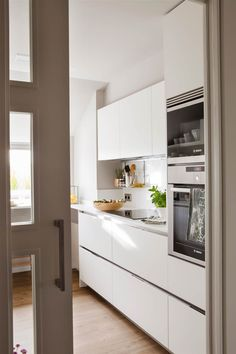 In this kitchen, a large window provides lots of natural light to the mostly wooden kitchen. Exposed shelves are used to store recipe books, and the… Mini Kitchen, Wooden Kitchen, New Kitchen, Kitchen Dining, Kitchen Cabinets, Small Kitchen Renovations, Kitchen Remodel, Small Flat Decor, Galley Kitchens