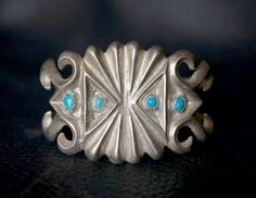 "Vintage Navajo Sand Cast Silver Butterfly Bracelet.This is a cool unusual old silver and turquoise sand-cast cuff, I can remember seeing a lot of these worn by the Navajo's in the 1960s. Sand cast items are Indian Hand Made items using a procedure developed by the Navajo silversmiths in the mid 1800s. It is a labor-intensive process. Measures 5 3/4"" inside including the gap. Weight 49.8 grams by FarRiderWest on Etsy"