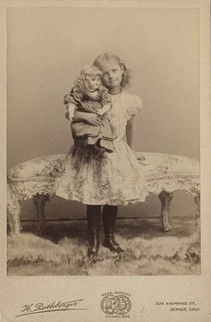 Girl and Bisque head Doll