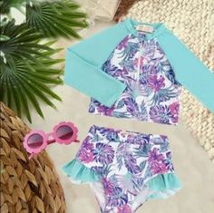 Girls Bathing Suits - Tulum Palm Trees Long Sleeve Let her spend her days catching rays and splashing away in our uniquely designed lovable Kryssi Kouture Exclusive swimsuits! Our swimsuits come in a style for every little & big gal.