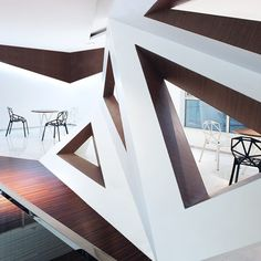 Triangular windows pierce the faceted walls that fold around at the Arthouse Cafe by Joey Ho, China «