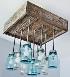Reclaimed Wood & Mason Jar Chandelier - a great DIY project if you have some leftover mason jars and wood at home. Mason Jar Light Fixture, Mason Jar Chandelier, Mason Jar Lighting, Mason Jar Lamp, Light Fixtures, Deco Luminaire, Luminaire Design, Decor Inspiration, Jar Lights