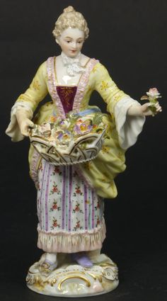 MEISSEN GERMAN PORCELAIN FIGURE OF WOMAN w FLOWER  Antique Meissen porcelain figure depicting a woman with basket of flowers. Finely hand painted throughout. Has white rocaille-moulded base enriched in gilt. 19th century.