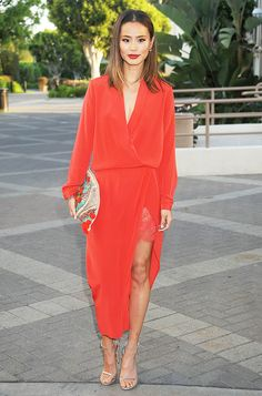 Jamie Chung in a vibrant longsleeve wrap dress and ankle strap heels