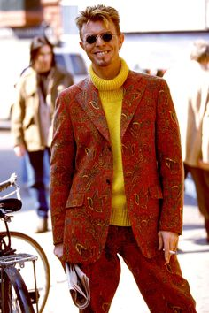1994-DAVID BOWIE in a paisley Suit and yellow turtleneck pictured in LONDON