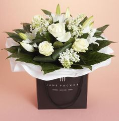 Would you not just LOVE flowers delivered in this way?! Jane Packer Flowers