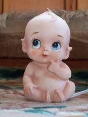 This reminds me of my Grandma Kate, she loved her Kewpie dolls!!