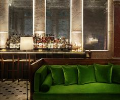 sexy is a emerald green velvet sofa in london...with a martini.