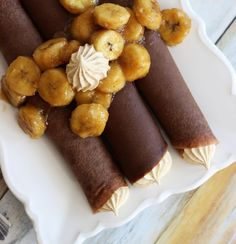 Chocolate Crepes with Peanut Butter Marshmallow Filling and Caramelized Bananas. Easier than they sound, and a super decadent breakfast treat!