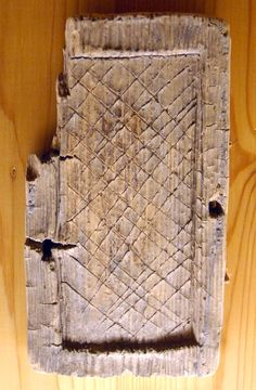 Novgorod. Wooden frame for wax tablet. I don't know any dating, but Novgorod was a big trading spot in the 12th century.