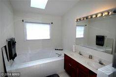 Master Bathroom with Soaking Tub.  See more at: SellMyHomeNOVA.com Are you looking to Buy, Sell, or Invest in Real Estate? Contact Us at: Info@AJTeamRealty or 703-562-1820!