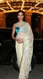 Deepika in this sexy net saree with satin tube choli and heavy choker set