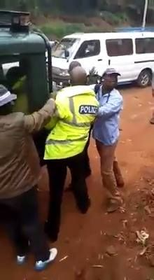 Angry Civilians Beat Up Corrupt Police Officer For Collecting Bribe And Take Him To The Station While His Colleagues Look On In Kenya