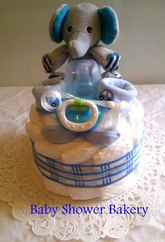 This sweet baby boy diaper cake is loaded with useful gifts that any new mom would love. It will make an adorable addition to any baby shower, and then it will be extremely useful once the baby arrives! $20 #diaper #cake #baby #shower #centerpiece #boy #Etsy #handmade