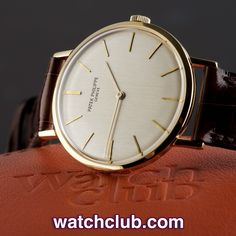 Patek Philippe Calatrava 3537 - Originally manufactured in 1972, the 18ct yellow gold case of this vintage ref.3537 has remained in superb condition over the last 42 years, as has the gorgeous silver lacquered dial with Patek Philippe signature at 12. Remarkably this 33mm dress watch has a larger appearance on the wrist due to to its incredibly slim profile (under 7mm in depth including the domed glass!) and super discreet bezel - for sale at Watch Club, 28 Old Bond Street, Mayfair, London