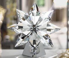 crystal Christmas star - This crystal Christmas star by Swarovski is a gorgeous ornament that is sure to brighten up anyone's Christmas. The Swarovski crystal Christmas . Christmas Tree Star Topper, Blue Christmas, Christmas Angels, Rustic Christmas, Christmas Ornaments, Christmas Trees, Beautiful Christmas Decorations, Homemade Christmas Decorations, Swarovski Ornaments