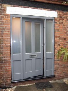 Soft grey with glass side panels. Entrance Doors, Garage Doors, Contemporary Front Doors, Passive House, House Front, Houzz, Blinds, Burnham, Victorian