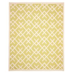 Flatweave wool rug with a latticework motif. Handmade in India.    Product: RugConstruction Material: Wool...