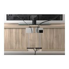 IKEA - BESTÅ, TV unit, black-brown, , It's easy to keep the cords from your TV and other devices out of sight but close at hand, as there are several cord outlets at the back of the TV bench.You can choose to stand the TV bench on the floor or mount it on the wall to free up floor space.If you want to organize inside you can complement with BESTÅ interior fittings.Steady on uneven floors, thanks to the adjustable feet.