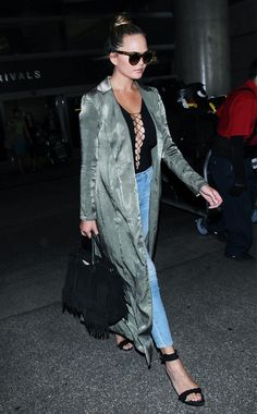 The One Item Chrissy Teigen Almost Never Flies Without via @WhoWhatWear