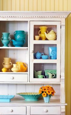 Vintage Pottery Collection displayed using a color theme. Grouping similar colors makes smaller items have larger impact. ~Mary Walds Vintage Place - Give collectibles the spotlight they deserve by displaying them in an appropriate setting.