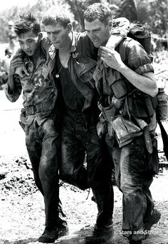 Vietnam, March, 1967: A wounded soldier gets an assist during a mud patrol by C Company, 2nd Battalion, 3rd Infantry, 199th Light Infantry Brigade about 15 miles south of Saigon. (Al Fasoldt ©Stars and Stripes) #VietnamWar #Vietnam #history #military