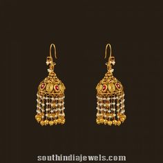 Gold antique hook style pearl drop earrings.