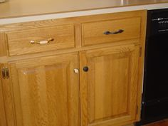 paint originals ORB color or buy new dark knobs, handles for our oak kitchen cabinets