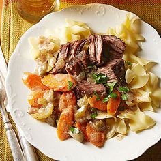 Slow Cooker German-Style Beef Roast. Tangy beef, flavored with red wine, dill pickles and mustard, will make any fan of German food raise a glass and say Prost! Serve the pot roast over tender noodles or spaetzle, tiny egg noodles available at specialty or European supermarkets. #slow_cooker #beef