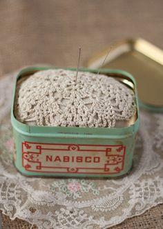 vintage box with a pincushion