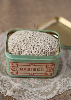 Vintage tin turned into a pincushion