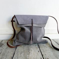 SPECIALTY DRY GOODS~jessica traveler bag perfect for passport, iPhone & travel map AND general wanderlusting handmade with leather remnants~assorted grey~one of a find small: x strap drop: cross chest up to My Bags, Purses And Bags, Leather Backpack, Leather Bag, Winter Looks, Grey Leather, Handmade Bags, Leather Craft, Leather Purses