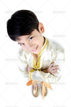 Asian cute boy in thai costume on white background . ...  aged, ancient, antique, asian, belt, boy, breast, cloth, costume, culture, cute, decoration, dress, fashion, garnish, gold, immemorial, lanna, male, model, old, ornament, red, smile, suite, thai, thailand, tradition, welcome